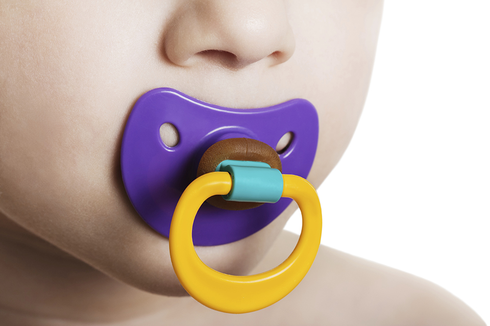 Child sucking a soother